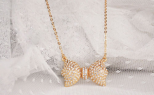 Crystal Bow Pendant Chain Necklace - Gold Tone